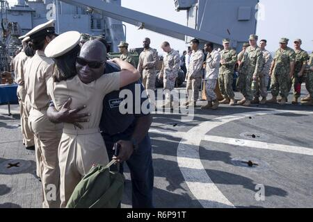 U.S. 5TH FLEET AREA OF OPERATIONS (Sept. 16, 2017) Sailors and Marines aboard the amphibious dock landing ship USS Pearl Harbor (LSD 52) congratulate the ship's newly frocked chiefs following a chief petty officer (CPO) pinning ceremony on the ship's flight deck. Pearl Harbor is part of the America Amphibious Ready Group (ARG) and, with the embarked 15th Marine Expeditionary Unit (MEU), is deployed in support of maritime security operations and theater security cooperation efforts in the U.S. 5th Fleet area of operations. - Stock Photo