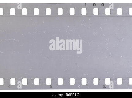 Strip of old celluloid film with dust and scratches - Stock Photo