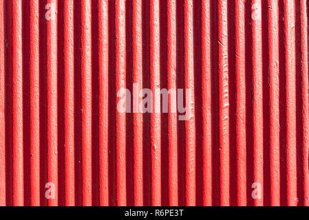 red background of corrugated iron - Stock Photo