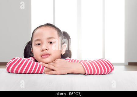 Excited asian children with relax lean on the table - Stock Photo