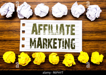 Handwritten text showing Affiliate Marketing. Business concept for Internet Online Written on sticky note, wooden with sticky, many folded paper white and yellow for difference or collaboration - Stock Photo