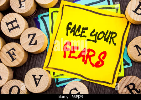 Handwriting Announcement text showing Face Your Fears. Business photo showcasing Challenge Fear Fourage Confidence Brave Bravery written on wooden abckground with letters - Stock Photo