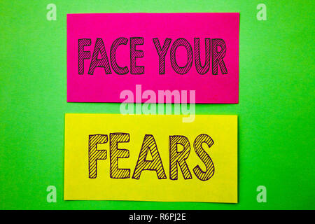 Handwriting Announcement text showing Face Your Fears. Conceptual photo Challenge Fear Fourage Confidence Brave Bravery written on sticky note paper on the green background. - Stock Photo