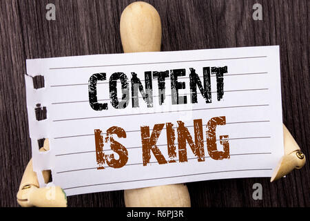 Word, writing, text  Content Is King. Conceptual photo Online Marketing Information Management With cms Or Seo Data written on torn paper holding by sculptureon the wooden background - Stock Photo