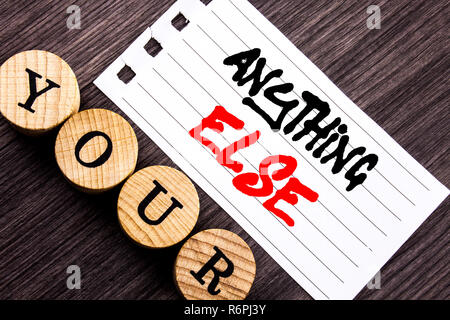 Writing text showing  Anything Else. Business photo showcasing Ask Asking Question to Have Answer written on tear note paper sticky note on the wooden background. - Stock Photo