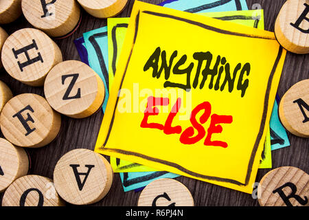 Handwriting Announcement text showing Anything Else. Business photo showcasing Ask Asking Question to Have Answer written on wooden abckground with letters - Stock Photo