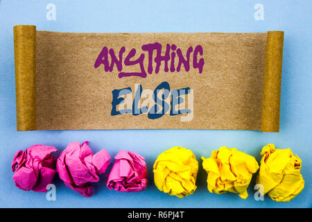 Handwriting text showing Anything Else. Concept meaning Ask Asking Question to Have Answer written on tear sticky note Paper on the blue background Folded paper - Stock Photo
