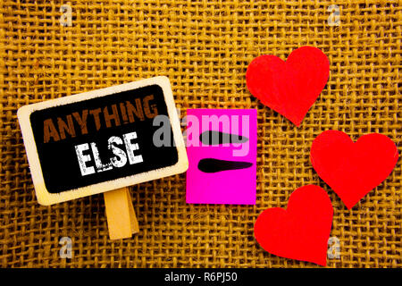Writing text showing  Anything Else. Concept meaning Ask Asking Question to Have Answer written on blackboard equation Meaning Love Heart on the textured background - Stock Photo
