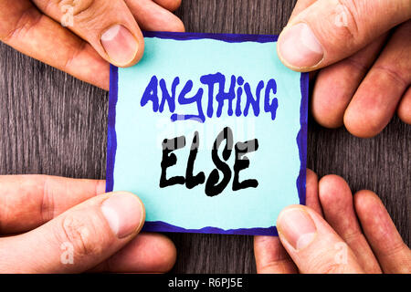 Handwriting Announcement text showing Anything Else. Conceptual photo Ask Asking Question to Have Answer written on Sticky Note Paper Holding Hand with Finger. - Stock Photo