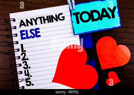 Announcement text showing Anything Else. Concept meaning Ask Asking Question to Have Answer written on notebook book paper on the wooden background Today Love Heart. - Stock Photo