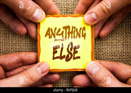 Conceptual hand writing showing Anything Else. Business photo showcasing Ask Asking Question to Have Answer written on Sticky Note Paper Holding Hand with Finger. - Stock Photo