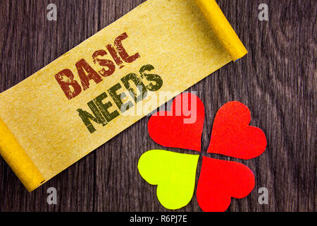 Word, writing, text  Basic Needs. Conceptual photo Health In Developing Countries Essential Food Lack written on Sticky Note Paper with Love Heart Next to it on the wooden background. - Stock Photo