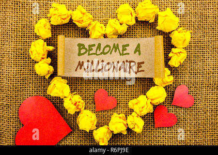 Handwriting Announcement text showing Become A Millionaire. Concept meaning Ambition To Become Wealthy Earn Fortune Fortunate written on Sticky Note Paper With Heart on the textured background - Stock Photo