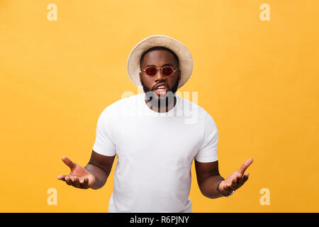 Young african american man wearing white t-shirt shouting and screaming loud to side with hand on mouth. Communication concept. - Stock Photo
