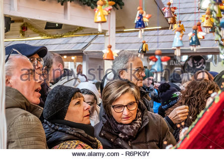 Turin, Italy. 2nd December, 2018. People interested in some items in a stall. © Simone Migliaro / Awakening - Stock Photo