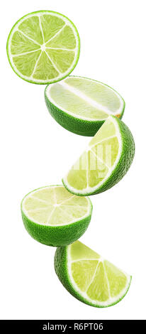 Slices lime flying in the air isolated on white background. Clipping Path. Full depth of field. - Stock Photo