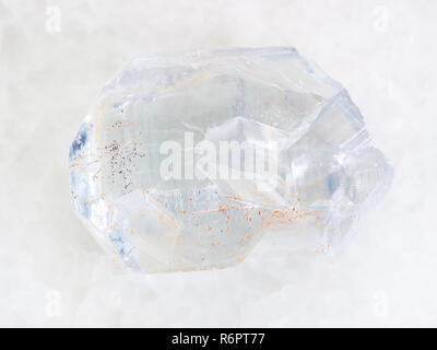 raw crystal of celestine stone on white marble - Stock Photo