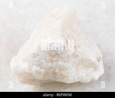 raw anhydrite stone on white - Stock Photo