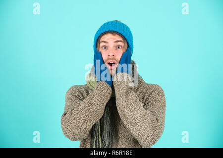 Man wear knitted accessory turquoise background. Winter accessories concept. Winter fashion knitted clothes. Knitted accessories as hat and scarf. Man knitted hat gloves and scarf winter fashion. - Stock Photo