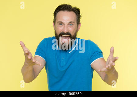 What are you doing. Stop annoying him. Overwhelmed with emotions. Handsome shouting mature man screaming standing against yellow background. Man bearded irritated annoyed can not keep calm anymore. - Stock Photo