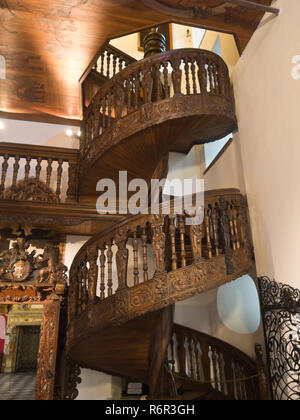 Inside the Historical museum of Gdansk Poland situated in the old town hall, ornate spiral wooden staircase - Stock Photo