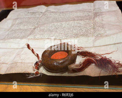 Inside the Historical museum of Gdansk Poland situated in the old town hall, old historical documents with wax seal - Stock Photo