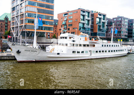 Hamburg, Germany - September 07, 2017: ship at ferry pier on cityscape background. River transport, transportation. Water travel, travelling, trip. Vacation, discovery, wanderlust. - Stock Photo