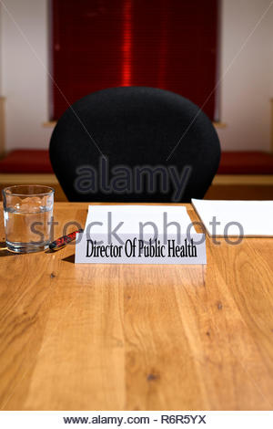 Director Of Public Health, NHS job title shown on nameplate, meeting table, England, UK - Stock Photo