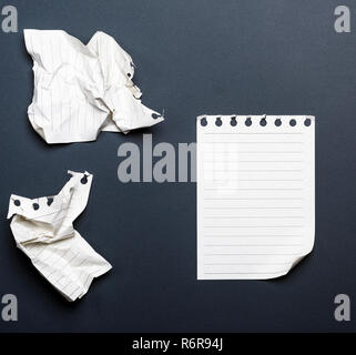 white sheets of a diary with a curved corner - Stock Photo