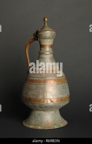 ancient oriental metal jug on dark background. antique bronze tableware - Stock Photo