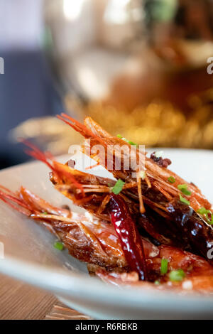 Three Prawns on White Plate Cooked Delicious Closeup Asian Cuisine - Stock Photo