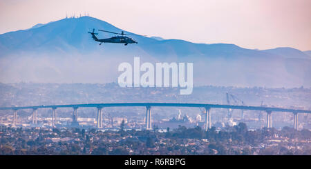 Helicopter above Coronado bridge in San Diego city - Stock Photo