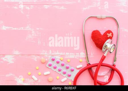 World health day, Healthcare and medical concept. Red heart with Stethoscope, notepad or notebook, thermometer and yellow Pill on Pastel white and blue wooden table background texture. - Stock Photo