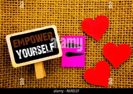 Writing text showing  Empower Yourself. Concept meaning Positive Motivation Advice For Personal Development written on blackboard equation Meaning Love Heart on the textured background - Stock Photo