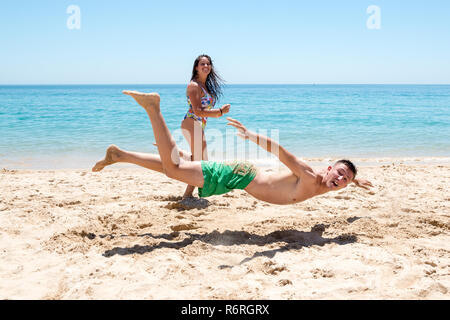 Friends having fun at the beach - Stock Photo