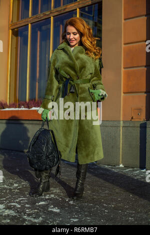 Redhead woman wearing winter clothes outdoors - Stock Photo