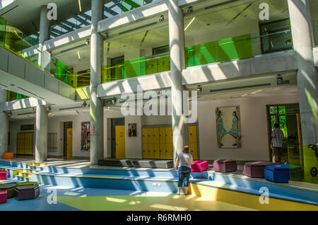 Dilijan,Armenia,August 24,2018:View of the hallway with paintings on the walls, painted by students and illuminated by daylight coming from the ceilin - Stock Photo