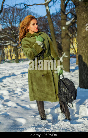 Fashion woman wearing winter coat outdoors - Stock Photo