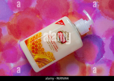 dispenser bottle of Imperial Leather Shea Butter & Manuka Honey antibacterial hand wash handwash on colourful background - Stock Photo