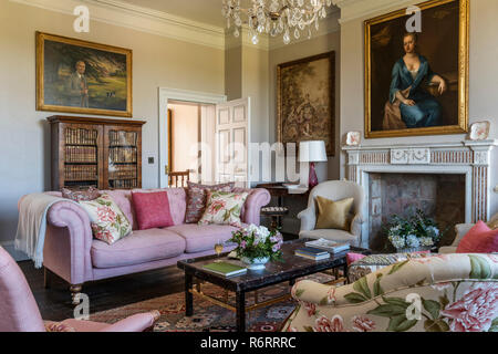 18th century Goodnestone estate Portrait of Fanny Fowler above fireplace in drawing room with pink sofa in 18th century Goodnestone mansion - Stock Photo