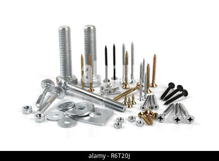 variety of screws and fasteners isolated on white background - Stock Photo