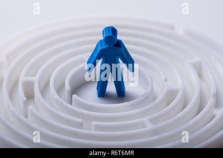 Human Figure Standing In Center Of Maze - Stock Photo
