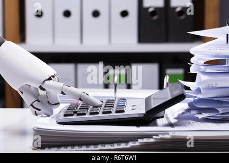 Robot Using Calculator - Stock Photo