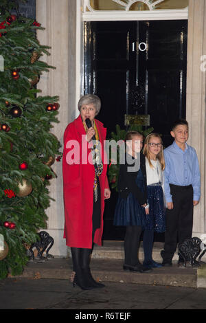 10 Downing Street, London, UK. 6 December, 2018. British PM Theresa May switches on the Christmas tree lights in Downing Street with members of the Military Wives Choirs performing carols.Credit: Malcolm Park/Alamy Live News. - Stock Photo
