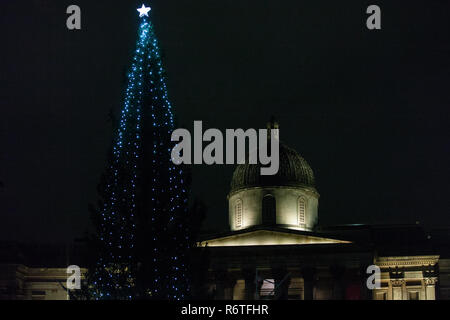 London, UK. 6th December, 2018. The annual ceremony to switch on the lights on the Christmas tree in Trafalgar Square. A spruce tree selected from the forests surrounding Oslo has been gifted to the UK by the Norwegian government in gratitude for its support during World War II since 1947. Energy-efficient light bulbs are now used to decorate the tree. Credit: Mark Kerrison/Alamy Live News - Stock Photo