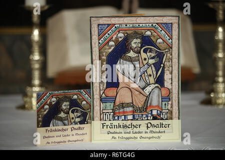 Lichtenau, Germany. 06th Dec, 2018. The church dialect hymnbook 'Fränkischer Psalter - Psalmen und Lieder in Mundart - As fränggische Gsangsbuch' as well as an audio book about it can be found in the Trinity Church. The special hymnbook for Franconia contains not only the Franconian 'Our Father', but a total of 23 biblical psalms and 44 songs on 80 pages. Including dialect versions of well-known Christmas songs. (to dpa-Korr: 'Vadder unser - Franken gets church dialect songbook' from 07.12.2018) Credit: Daniel Karmann/dpa/Alamy Live News - Stock Photo