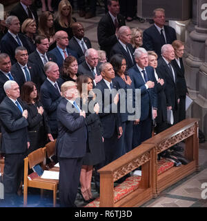 Dignitaries pay their respects as the casket containing the remains of the late former United States President George H.W. Bush at the National funeral service in his honor at the Washington National Cathedral in Washington, DC on Wednesday, December 5, 2018. Front row: United States President Donald J. Trump, first lady Melania Trump, former US President Barack Obama, former US President Bill Clinton, former US Secretary of State Hillary Rodham Clinton, former US President Jimmy Carter, former first lady Rosalynn Carter. Second row: US Vice President Mike Pence, Karen Pence, former US Vice - Stock Photo