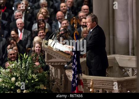 Former President George W. Bush delivers the eulogy for his father, former President George H.W. Bush, at his State Funeral at the National Cathedral December 5, 2018 in Washington, DC. Bush, the 41st President, died in his Houston home at age 94. Stock Photo