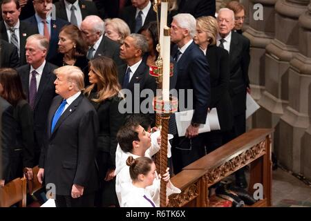 U.S. President Donald Trump and First Lady Melania Trump join former presidents and first ladies as the flag draped casket of former president George H.W. Bush is carried down the aisle of the National Cathedral at the State Funeral December 5, 2018 in Washington, DC. Standing from left to right are: President Donald Trump, First Lady Melania Trump, President Barack Obama, First Lady Michelle Obama, President Bill Clinton, First Lady Hillary Clinton, President Jimmy Carter and First Lady Rosalynn Carter.  Bush, the 41st President, died in his Houston home at age 94. - Stock Photo
