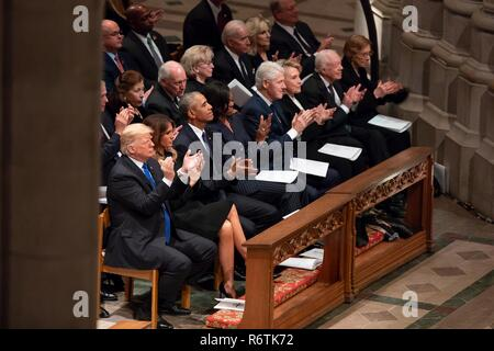 U.S. President Donald Trump and First Lady Melania Trump join former presidents and first ladies during the State Funeral for former president George H.W. Bush at the National Cathedral at the State Funeral December 5, 2018 in Washington, DC. Standing from left to right are: President Donald Trump, First Lady Melania Trump, President Barack Obama, First Lady Michelle Obama, President Bill Clinton, First Lady Hillary Clinton, President Jimmy Carter and First Lady Rosalynn Carter.  Bush, the 41st President, died in his Houston home at age 94. - Stock Photo